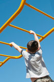 Boy on monkey bars Stock Photos