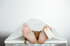 Boy on a mortuary table with bound legs Royalty Free Stock Photos