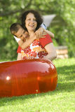 Boy with mother. Relaxing on summertime Stock Photography