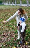 Boy with mother 5. Young boy with mother in park. 5 Royalty Free Stock Image