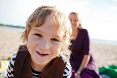 Boy and mother and the beach. Royalty Free Stock Photos