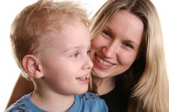 Boy with mother behind royalty free stock photo