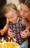 Boy with mother celebrating birthday Stock Photo