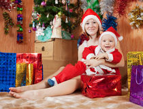 Boy  with mother  celebrating Christmas Royalty Free Stock Image
