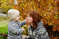 Boy with mother in fall Royalty Free Stock Photography