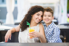 Boy and mother or happy family having healthy breakfast in resort cafe outdoor Royalty Free Stock Photos
