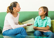 Boy and  mother having serious talking. Teenage boy and  mother having serious talking in home Stock Images