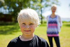 Boy and mother outdoors Royalty Free Stock Photography