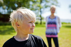 Boy and mother outdoors Royalty Free Stock Photos