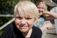 Boy and mother outdoors Stock Photo