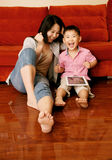 Boy and mother playing games with tablet Stock Photo