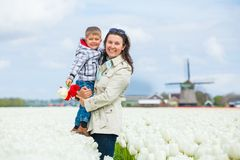 Boy with mother in the purple tulips field Royalty Free Stock Photography