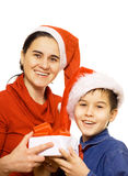 Boy and mother with Santa's hat. Mother with her son at Christmas time - isolated royalty free stock image