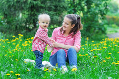 Boy with mother take rest. In summer park Stock Images