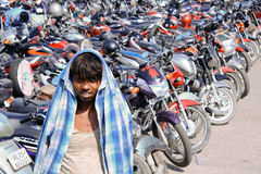 Boy in motor cycle park Royalty Free Stock Image