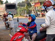 Boy on a Motorbike Royalty Free Stock Images