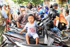 Boy on motorbike Royalty Free Stock Image