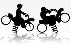 Boy on the motorbike Royalty Free Stock Photo