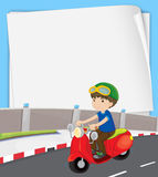 Boy on motorbike Royalty Free Stock Photography