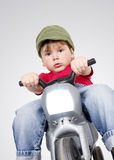 Boy on a motorcycle. Royalty Free Stock Photo