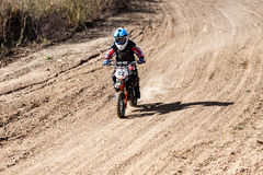 Boy during motorcycle cross-country competition Royalty Free Stock Image