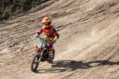 Boy during motorcycle cross-country competition Stock Photos
