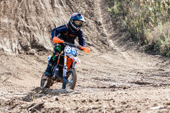 Boy during motorcycle cross-country competition Royalty Free Stock Images
