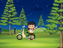 Boy and motorcycle in the park Royalty Free Stock Photography