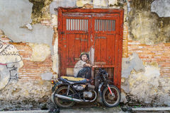 'Boy on Motorcycle' street art,  George Town, Penang, Malaysia. Royalty Free Stock Photos