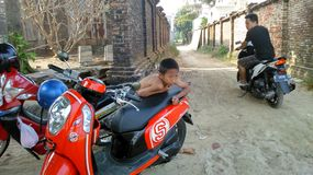 Boy and motorcycle Stock Image