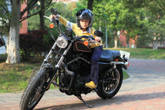 Boy on motorcyle Stock Images