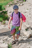 Boy on mountain trail Royalty Free Stock Photo