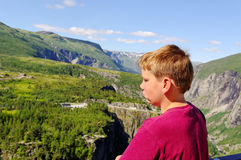 Boy and mountains. Stock Photography