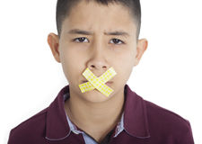 Boy mouth is glued to a band Royalty Free Stock Images
