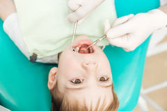Boy with mouth opened during oral inspection in dental clinic Royalty Free Stock Photos