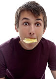 Boy mouthful potato chips Stock Image