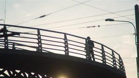 Boy Moves On Segway On The Bridge stock footage