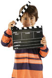 Boy with movie clapper board Royalty Free Stock Photo