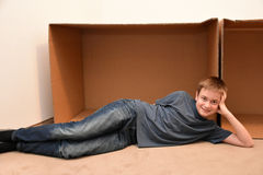 Boy and moving boxes Royalty Free Stock Photos