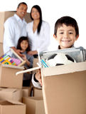 Boy moving house Royalty Free Stock Photography