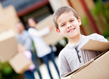 Boy moving house Stock Photo
