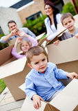 Boy moving house with family Royalty Free Stock Photography