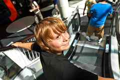 Boy on a moving staircase Stock Image