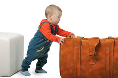 Boy is moving the suitcase Royalty Free Stock Photo