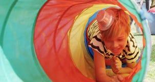 Boy moving through tent tunnel 4k. Happy boy moving through tent tunnel 4k stock video