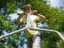 Boy mowing the lawn Royalty Free Stock Photo