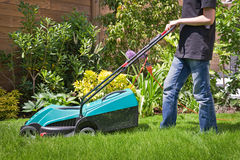 Boy mowing the lawn Stock Image