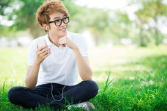 Boy with mp3 player. Portrait of a teenage boy listening to mp3 player outdoors Stock Photos