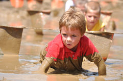 Boy in mud race. Competing in mud race for the Merrell Down and Dirty. Fairmont Park, PA Stock Photos