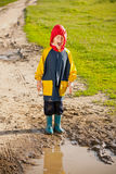 Boy in a muddy puddle Royalty Free Stock Images